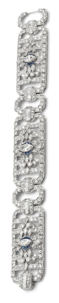 An Art Deco diamond and sapphire bracelet Designed as three articulated openwork geometric panels, each set to the centre with a marquise-cut diamond and calibre-cut sapphire detail, and set throughout with variously-cut diamonds, interspersed by similarly set diamond geometric spacer links and concealed clasp, length 19 cm, French assay mark, stamped 'platinum'.