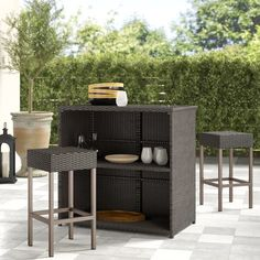 Gear up for casual cocktails and wine nights on the deck with this three-piece patio bar set. Designed to live outdoors, each piece in this weather-resistant set is crafted with an iron inner frame that's wrapped in woven resin wicker in a dark brown hue. The rectangular table that anchors this set features two shelves along the back that provide a place for mixers, barware, and beyond. A pair of square bar stools round out the set and allow you to sit beside a buddy. Assembly is required. Outdoor Bar Sets, Outdoor Bar Cart, Patio Bar Set, Outdoor Decor, Rattan Bar Stools, Bar Stool Seats, Metal Bar Stools, Balcony Bar, Portable Bar