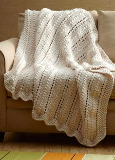 Free Knitting Pattern for Easy Lacy Throw in Super Bulky Yarn - I'm knitting this afghan now and it IS super easy. This easy lace afghan is a two-row repeat with one of the rows being purl stitches. As a bonus it's a quick knit in super bulky yarn!