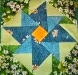 My Icon Block This free block pattern: Spring Posies @ AZpatch I made this block as a Round Robin center medallion returned . Mug Rug Tutorial, Patchwork Tutorial, Tumbling Blocks Quilt, Quilt Blocks, Quilt Block Patterns, Pattern Blocks, Quilting Tools, Quilting Ideas, Work Gifts