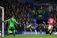 Chelsea's Brazilian midfielder Willian has an unsuccessful shot as Manchester United's Spanish goalkeeper David de Gea prepares to block during the...