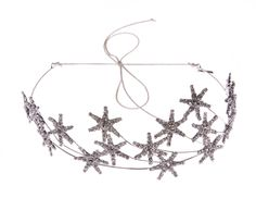For a wedding hairstyle that's out of this world, stand out in the Jennifer Behr Zenith Crown. With Swarovski crystal stars placed on delicate wire, this wedding headpiece is for one confident bride.