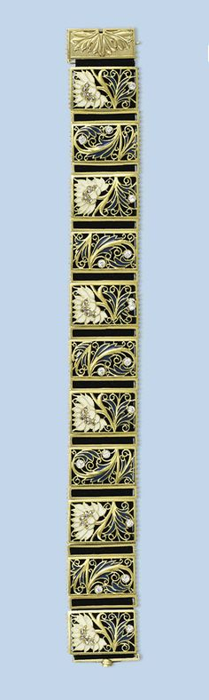 AN ANTIQUE ART NOUVEAU BRACELET   Composed of 9 pierced panels strung to a black woven strap, each with a white and blue enamelled Chrysanthemum with diamond detail, circa 1900, 19.0 cm long
