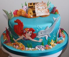 My daughter wanted a cake with Ariel, dolphins and a...