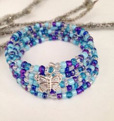 Shades of blues and Purple Women's Memory Wire Bracelet with butterfly  or heart Charm Seed beads Silver Wire