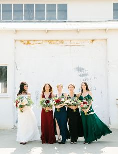 Coastal California Wedding with bridesmaids in bold colored dresses