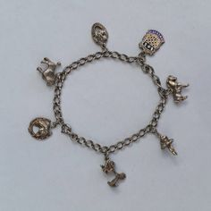 Charm Bracelet Complete with 7 Charms . Vintage, Sterling Silver. by LittleVintageCharmCo on Etsy #vogueteam #vintagecharmbracelet