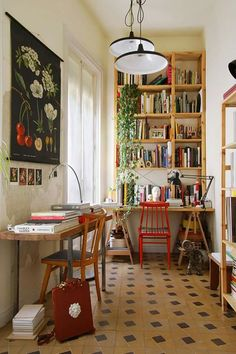 Workspace inspiration: simple wooden bookshelves + freestanding wooden shelving. Plants. Pops of red.