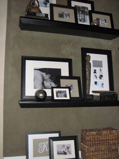 floating shelves filled with frames
