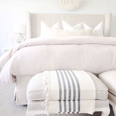 Monochromatic bedroom features a linen slipcovered wingback bed dressed in linen… Monochromatic bedroom features a linen slipcovered wingback bed dressed in linen bedding alongside a pair of french linen stools. White Bedroom, Master Bedroom, Bedroom Decor, 1920s Bedroom, Gold Bedroom, Design Bedroom, Linen Headboard, Linen Bedding, Bedding Sets