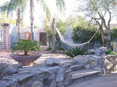 Private home in a magical setting makes this a Catalina foothills sanctuary.