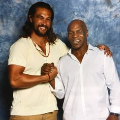 Pin for Later: 27 Times Jason Momoa Almost Burst Out of His Shirt (and We All Crossed Our Fingers) When he dwarfed Mike Tyson, and his button-up tee took one for the team.