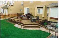 deck...large landing area outside back door, cascading steps to more deck, more cascading steps, with walkway around
