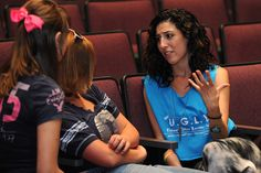 Devyn Rush, spokesperson for bullying prevention organization Hey Unique Gifted Loveable You, or Hey UGLY, speaks with students Aug. 16 at Sand Creek High School in Falcon School District 49. The school's students sold the most tickets to the district's Stand Up. Speak Out. anti-bullying concert Aug. 17 at Security Service Field in Colorado Springs.