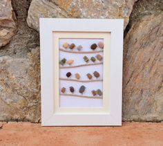 Birds On A Wire: Beach Pebble Picture in White by kormendesigns