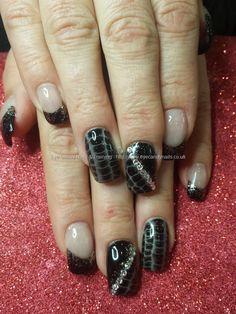 Black gel with snakeskin gel polish and swarovski crystals