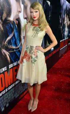 Taylor Swift looking cute per usual in a floral-print dress and heels with a bright red lip. #fashion
