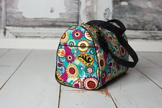 A stunning, rockabilly-inspired bag in both handbag and overnighter sizes. Large side slip pockets, a zippered lining compartment, and a removeable crossbody strap make it as functional as it is stylish. You'll want to make a Blanche for everybody you know.