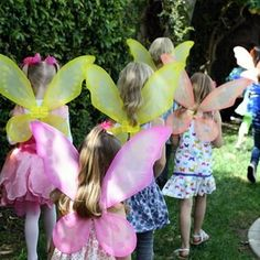 Each little girl receives a red, green or white fairy wings to wear during the party