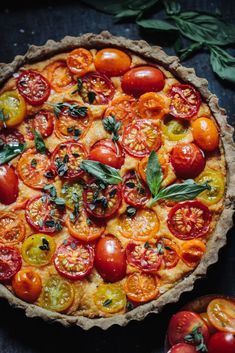 Heirloom Tomato Tart with a Walnut Base (Vegan & Gluten Free) A super easy & healthy tart recipe packed with flavour. Perfect for a quick lunch or dinner. #vegan #tomatorecipes #easyrecipe #lunch #glutenfree #tart #vegantart #veganquiche #tomatotart