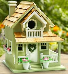 Garden Bird Cottage - YellowThis one-of-a-kind birdhouse in yellow features a distinctive wrap-around porch with rear stairs, as well as the traditional front stoop. A gable-covered balcony adorns the front of the house. The Garden Bird Cottage has two Decorative Bird Houses, Bird Houses Painted, Bird Houses Diy, Fairy Houses, Nantucket Cottage, Birdhouse Craft, Landscaping Around House, Bird House Plans, Backyard Birds