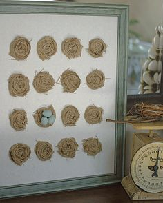 diy art using fabric rosettes to resemble bird nests