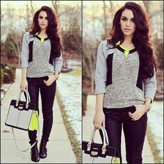 Grey and black colourblock jumper, neon yellow pendant necklace, black jeans, colourblock bag and black booties
