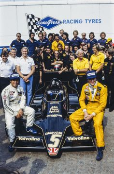Lotus team with Mario Andretti and Ronnie Peterson sitting on a Lotus 79 Ford. Colin Chapman and Nigel Bennett are also visible. Lotus F1, Lotus Auto, Mario Andretti, Goalie Mask, Formula 1 Car, F1 Drivers, Team Photos, F 1, Grand Prix