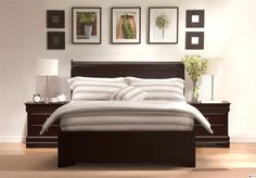 How to arrange pictures over a bed.