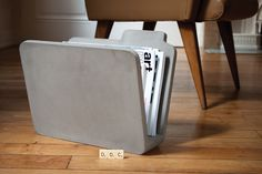 The Doc Concrete Magazine Rack reflects a folder on your computer desktop. It suggests a return to paper and invites us to review the importance of the digital world in our daily lives. Design Bertrand Jayr
