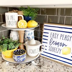 Summer fun with a lemon and blue and white tiered tray by Stager Roz Blue Yellow Kitchens, Blue And Yellow Living Room, Navy Living Rooms, Lemon Kitchen Decor, Yellow Kitchen Decor, Kitchen Themes, Kitchen Ideas, Kitchen Redo, Kitchen Centerpiece