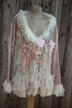 Whimsy vintage lacy knit, altered couture; reworked with intricate details to discover. The knit has been hand dyed in shade of very pale blush/peach, the hems are draped with buttercream shade lace and delicate sof tulle flounces, ´the front is draped with blush lace, antique linen