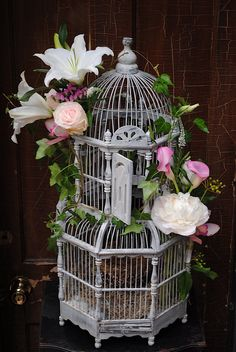 A sweet way to detail a birdcage.  Perfect for guests to fill with their cards or wishes for bride and groom!