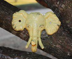 Pale Yellow-Elephant Hook-Cast Iron-Wall Hooks-Safari-Shabby Chic-Key Hanger-Coat Rack-Nursery-Anthropologie Inspired. $12.99, via Etsy.
