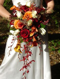 Fall Tones Bridal Bouquet Filled with orchids, roses and mango calla lilies the Rich tones of fall make this stunning bouquet a perfect choice for the fall-autumn tones. No matter what time of year the wedding this bouquet stands out and gets noticed! Cascading Wedding Bouquets, Bridal Bouquet Fall, Fall Wedding Flowers, Fall Wedding Colors, Bride Bouquets, Fall Flowers, Floral Wedding, Bridal Gown, Trendy Wedding