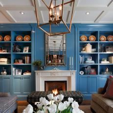Beautiful Blue Bookshelves in Traditional Living Room