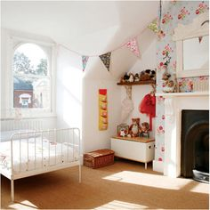 floral pattern paper, the fireplace, the crib, bunting, window. everything is really good.