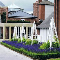Some of our large wooden garden obelisks at The Belfry Hotel near Birmingham. These are 8 foot tall and stand in beds of lavender with climbing roses up each obelisk