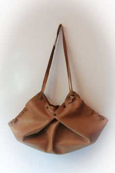 Leather origami handbag all handmade. $65.00, via Etsy.