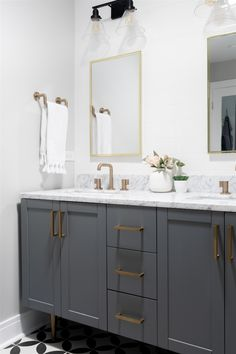 Above the vanity, there's a skylight that floods the space with natural light. The perfect spot for doing makeup! Navy Accent Walls, Navy Walls, Light Gray Cabinets, Light Gray Paint, White Vanity, Large Bathrooms, Modern Dining Table, Master Bathroom, Bathroom Vanities