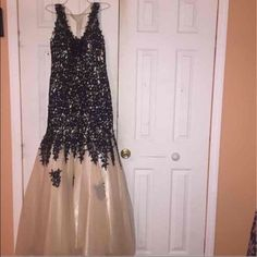 Prom dress Only wore one time, in wonderful condition. Originally $450. Black lace with tulle. Size 6. Cup size fits a C or D Dresses Prom