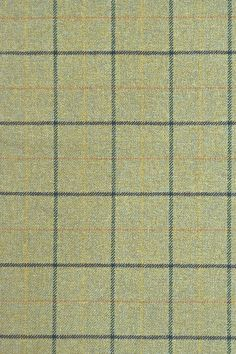 Bennachie Tweed Lambswool Fabric 100% Lambswool tweed upholstery fabric in soft green with thick dark blue and green grid check and autumnal yellow and orange window check.