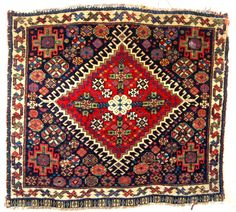 Super antique Qasgqai bag face. Circa 1875. 54 x 58cm. Softest wool and intense dyes. Great pile too only a few minor edge losses to the top left side. Silk wefted. A  ...