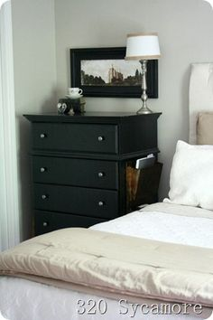 Magazine rack attached to dresser instead of separate nightstand...great idea in small bedroom space