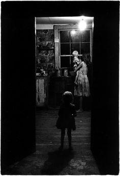 William Gedney. Girl holding little boy in kitchen, Kentucky, 1964