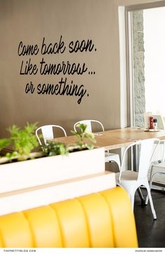 The walls of Stacked Diner are adorned with paintings of quotes in curvaceous black lettering, adding a hint of playfulness. Burger Toppings, Real Quick, Restaurant Design, Selena, Signage, Restaurants, Projects To Try, Walls, Paintings