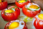 Tons of healthy (paleo) recipes including this... Egg and pesto stuffed tomatoes
