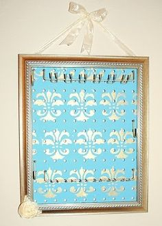 Jewelry organizer made out of a picture frame cardboard scrapbook