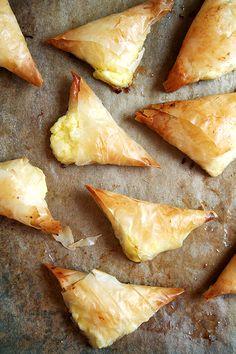 Tiropitas  1/2 lb. feta cheese, crumbled  1/2 lb. cottage cheese, small curd  3 eggs, beaten  1/2 tsp. salt  1/2 lb. fillo dough*, thawed  1/2 lb. unsalted butter, melted
