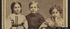"""In the early 1860s, photographs of children dubbed """"white"""" slaves were circulated as part of a campaign to raise money for public schools for emancipated slaves.  In the photos the children--who included a black boy named Isaac White, and four other bi-racial children Charles Taylor, Rebecca Huger, Rosina Downs and Augusta Broujey--were adorned in their Sunday's best, wrapped in American flags with captions that told readers of how they were turned away from a PA hotel """"on account of color."""""""